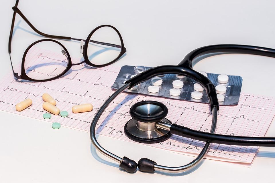 Medication, stethoscope, glasses, heart rate